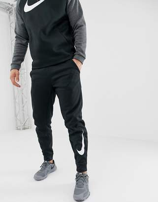 8cd1be1711c Nike Training Therma Tapered Swoosh Joggers In Black 932257-010