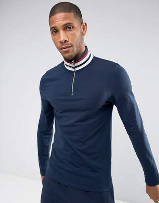 Asos DESIGN muscle fit Long Sleeve T-Shirt With Retro Stripe Rib And Zip Neck