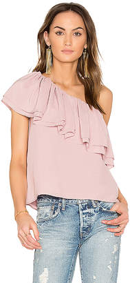 Endless Rose Asymmetrical Ruffle Top in Rose $78 thestylecure.com