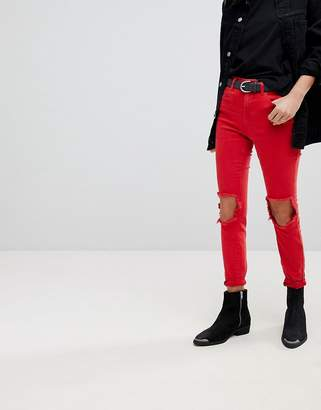 Blank NYC Skinny Jeans With Ripped Knee