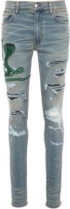 Amiri Snake appliqué paint splatter ripped skinny jeans