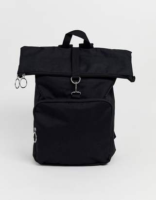 Asos Design DESIGN backpack in black with roll top and front pocket