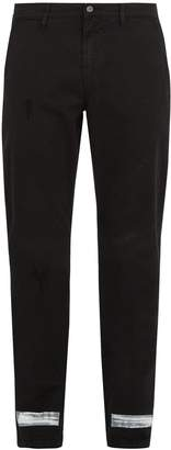 OFF-WHITE Diagonal-print slim-leg jeans $493 thestylecure.com