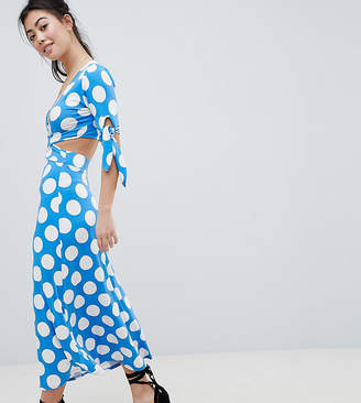 Asos DESIGN Petite wrap front tea dress with bow sleeve in polka dot