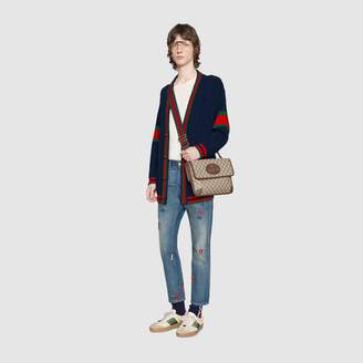 Gucci Embroidered tapered denim trousers