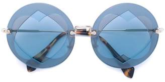 Miu Miu Collection round sunglasses