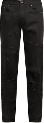 SAINT LAURENT Distressed skinny jeans $850 thestylecure.com