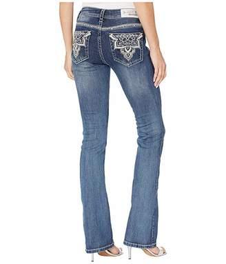 Grace in LA Mid-Rise Bootcut Flower Baroque Jeans in Medium Blue