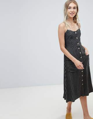 Warehouse midi cami dress with button front detail in black stripe