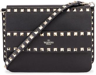 Valentino Rockstud Crossbody Camera Bag in Black | FWRD