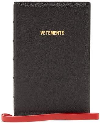Vetements Ulrich logo-print leather book clutch