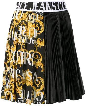 Versace logo band asymmetric pleated skirt