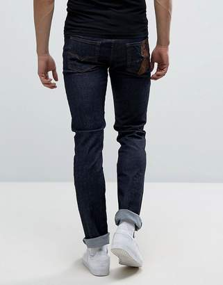 Versace Muscle Fit Skinny Jeans In Blue