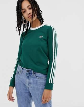 adidas adicolor three stripe long sleeve t-shirt in green