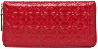 Comme des Garcons Star Embossed Long Wallet in Red | FWRD