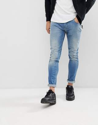 Love Moschino Skinny Fit Jeans In Midwash Blue With Distressing