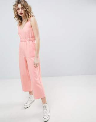 Asos Design Denim Jumpsuit With V Neck In Washed Pink