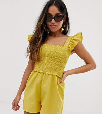 ca97f367d0 Asos DESIGN Petite shirred playsuit with frill sleeve