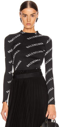 Balenciaga Long Sleeve Rib Knit Top in Black & White | FWRD