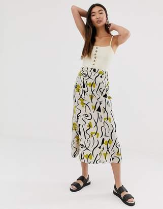Monki abstract face print midi skirt in light beige