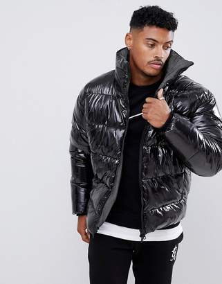 Asos DESIGN puffer jacket in high shine fabric with check lining