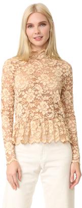 Ganni Flynn Lace Blouse $155 thestylecure.com