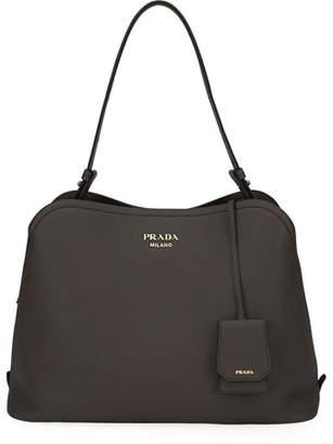 6bd69e85b6cb3d Prada Pebbled Leather Handbag - ShopStyle