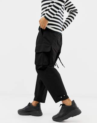 Asos DESIGN cargo pants with strapping in black