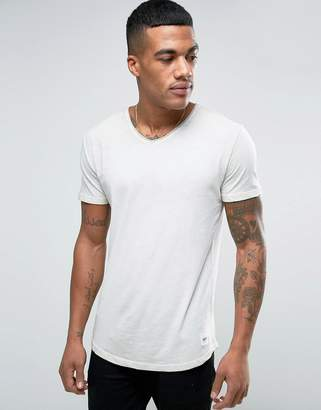 Solid V-Neck T-Shirt In Wash With Raw Edges $32 thestylecure.com