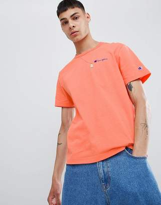 Champion t-shirt with small script logo in peach
