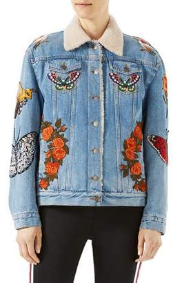 Gucci Embroidered Denim Jacket with Shearling Fur Lining, Light Blue $4,980 thestylecure.com