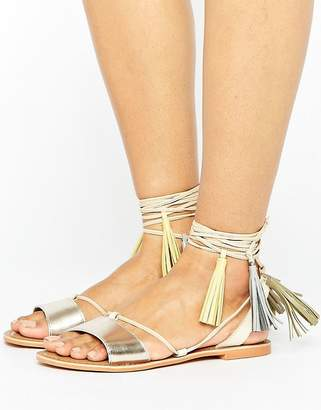 Glamorous Rose Gold Leather Tassle Tie Up Flat Sandals