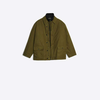 Balenciaga Light canvas jacket layered with fleece sweater