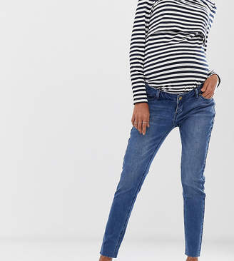 Bandia Maternity over the bump ankle graser skinny jean with raw hem and removable bump band
