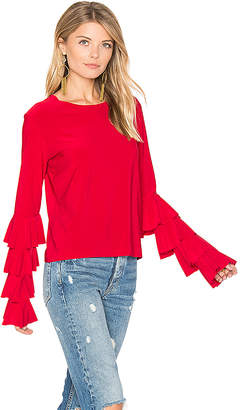 Norma Kamali x REVOLVE Ruffle Tee in Red $245 thestylecure.com