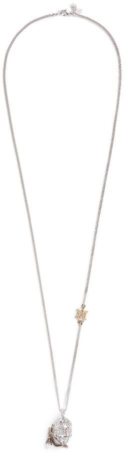 Alexander McQueenAlexander McQueen Swarovski crystal pavé piercing skull pendant necklace