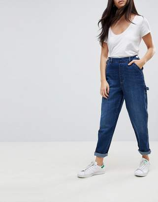Asos DESIGN carpenter jeans with button front detail in mid wash