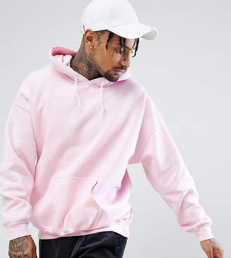 Reclaimed Vintage inspired oversized overdye hoodie in light pink