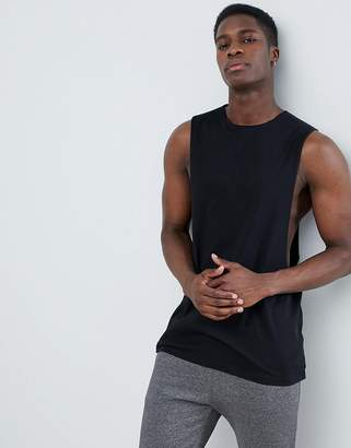 Asos DESIGN longline tank with extreme dropped armhole and raw edge in black