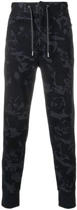 Alexander McQueen Camouflage print trousers