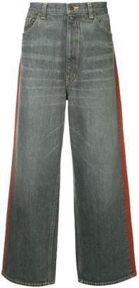 Facetasm wide leg denim trousers