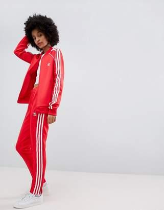 adidas adicolor Three Stripe Track Pants In Red