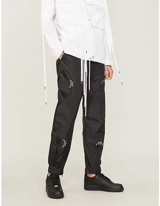 A-Cold-Wall* Metallic logo-print shell jogging bottoms