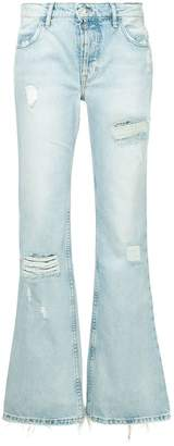 Adaptation distressed denim trousers