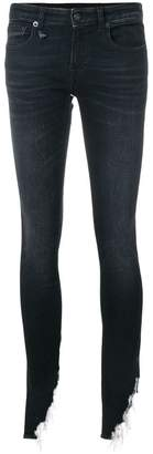 R 13 Kate shredded hem skinny jeans