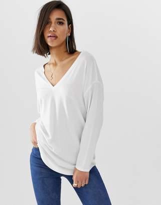 Asos Design DESIGN oversized tunic with v-neck in white