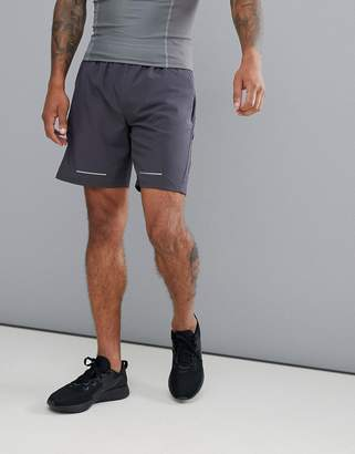 Asos 4505 training shorts in mid length with mesh panels and side pocket
