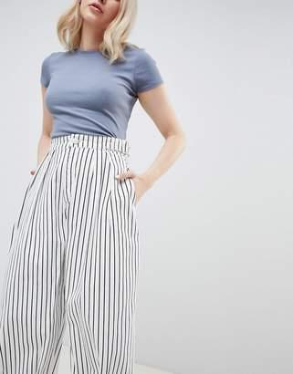 Asos DESIGN balloon leg jeans in white mono stripe with twisted seam detail