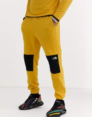 The North Face TKA Glacier pant in yellow