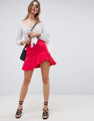 Asos Design DESIGN mini skirt with curved hem and frill